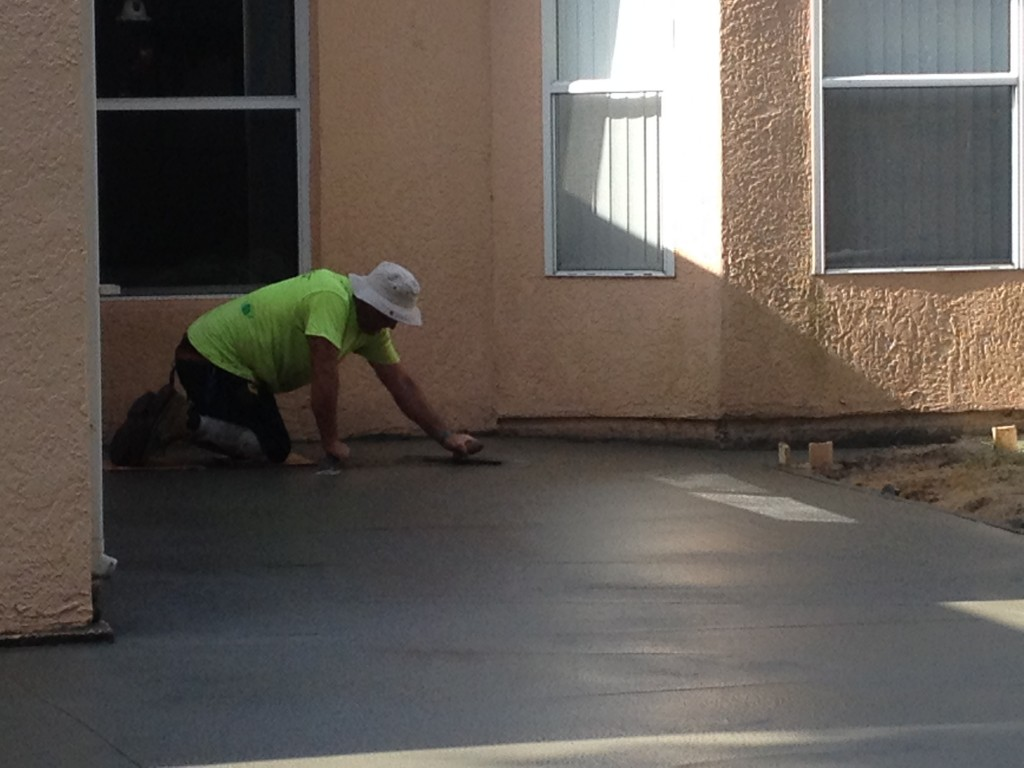 Smoothing out the concrete.