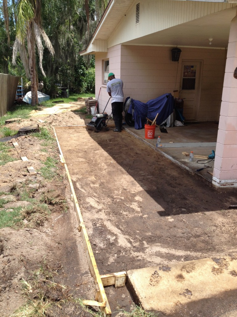 Working to get ready to pour the concrete driveway.